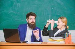Teacher and student on exam. back to school. formal education. businessman and secretary. paper work. office life. Business couple use laptop and documents stock images