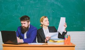 Teacher and student on exam. back to school. Formal education. businessman and secretary. paper work. office life royalty free stock image