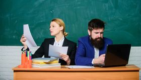 Teacher and student on exam. business couple use laptop and documents. back to school. Formal education. serious stock images
