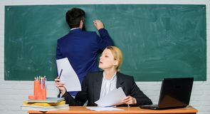 Teacher and student on exam. businessman and secretary. back to school. formal education. paper work. office life. Business couple use laptop and documents royalty free stock image