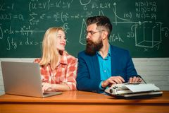 Teacher and student - good learning. Concentrated students following explanations of teacher in class. Teacher. Preparing for exam in college. Tutoring. Back royalty free stock images