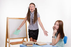 Teacher and student greatly surprised to hear Stock Images