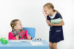Teacher and student happily smile at each other Stock Photography