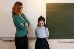 Teacher and student at laptop, girl pointing at screen royalty free stock photography