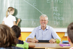 Teacher and student in lesson Royalty Free Stock Photography