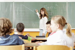 Teacher and student in lesson Stock Photography