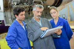 Teacher with student in metallurgy workshop Stock Photos