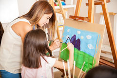 Teacher and student painting together Royalty Free Stock Image