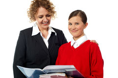 Teacher and student posing together Stock Images