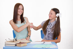 Teacher and student shake hands with each other Royalty Free Stock Photography