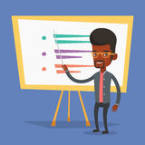 Teacher or student standing in front of board. Stock Photo