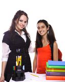 Teacher and Student standing in front of desk Stock Images