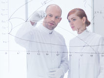 Teacher and student at transparent-board Royalty Free Stock Photos