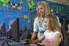 Teacher And Student Using Computer Royalty Free Stock Photography