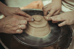 Teacher and student work on the potter's wheel Stock Photos