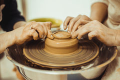 Teacher and student work on the potter's wheel Royalty Free Stock Photos
