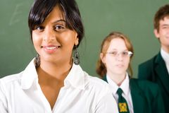 Teacher and students. High school teacher and students in classroom Royalty Free Stock Images
