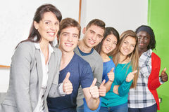 Teacher and students as a winning team Stock Photos