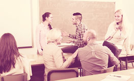 Teacher and students during break Royalty Free Stock Image
