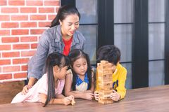 Teacher students are building toy block tower. Teacher and students are building toy block tower stock photos