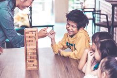 Teacher and students building toy block tower togetherness c. Teacher and students are building toy block tower togetherness classroom stock image