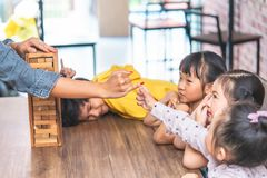 Teacher students are building toy block tower togetherness classroom. Teacher and students are building toy block tower togetherness classroom royalty free stock photos