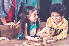Teacher students are building toy block tower togetherness classroom. Teacher and students are building toy block tower togetherness classroom royalty free stock photography