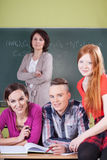 Teacher and students during chemistry lesson. Vertical Stock Images
