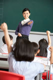 Teacher With Students In Chinese School Classroom Stock Image