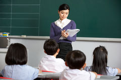 Teacher With Students In Chinese School Classroom stock photography