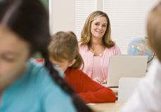 Teacher and students in classroom Stock Image