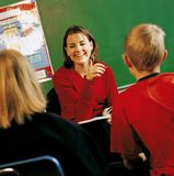 Teacher With Students In A Classroom Stock Images