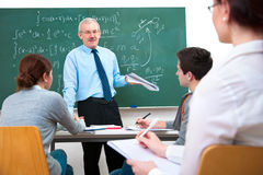 Teacher with students in classroom Stock Image