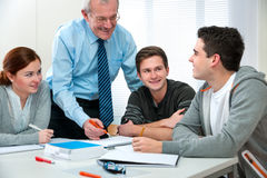 Teacher with students in classroom Stock Photo