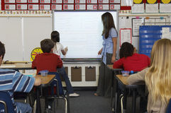 Teacher And Students In Classroom Royalty Free Stock Photo