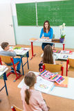 Teacher and students in the classroom.  Royalty Free Stock Photos