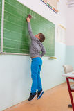 Teacher and students in the classroom: Clear the board.  Royalty Free Stock Image