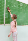 Teacher and students in the classroom: Clear the board.  Royalty Free Stock Photos