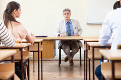 Teacher with students in classroom Stock Photos