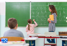 Teacher and students in the classroom: teaching.  Stock Photography