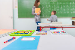 Teacher and students in the classroom: teaching.  Royalty Free Stock Image