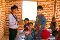 Teacher and students on the classroom at the village of Joate Stock Photo