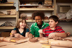 Teacher and students in clay studio Stock Photo