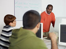 Teacher and students in college Royalty Free Stock Images