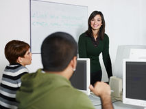 Teacher and students in computer class Royalty Free Stock Photo