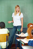 Teacher and students in elementary Royalty Free Stock Photos