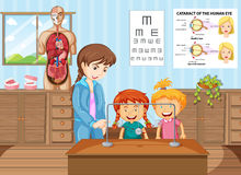 Teacher and students learning in science classroom Royalty Free Stock Image