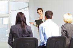 Teacher with students on seminar Royalty Free Stock Photos