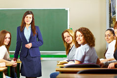 Teacher with students smiling Royalty Free Stock Image