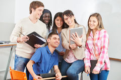 Teacher and students with tablet Stock Photo